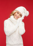 Woman in hat, scarf and mittens Stock Photos