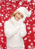 Woman in hat, scarf and mittens Royalty Free Stock Photography