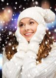 Woman in hat, scarf and mittens Royalty Free Stock Photos