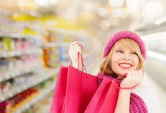 Woman in hat and scarf shopping at supermarket Royalty Free Stock Photography