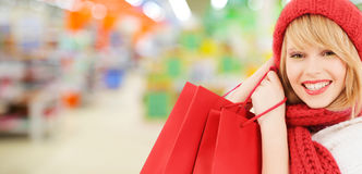 Woman in hat and scarf shopping at supermarket Royalty Free Stock Image