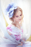 Woman with a hat in the shape of a flower on her head Royalty Free Stock Photos