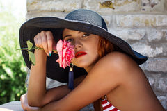 Woman in hat smell flower Royalty Free Stock Photo