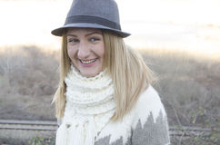 Woman with the hat smiling. Beautiful woman with the hatand scarf smiling Stock Photos