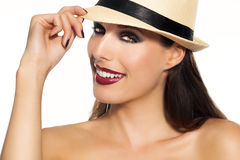 Woman In Hat. Smiling woman with dark red lipstick wearing hat Stock Photos