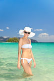 Woman in hat standing on the tropical beach Stock Photography