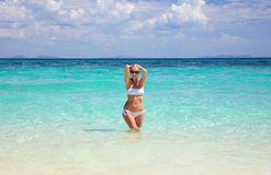 Woman in hat standing on the tropical beach Royalty Free Stock Photography