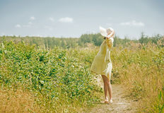 Woman in hat in summer Stock Photos