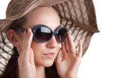 Woman in a hat and sunglasses. Isolated on white Stock Photography