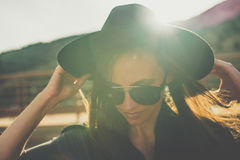 Woman with hat and sunglasses Stock Photos