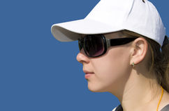 Woman in a hat and sunglasses Stock Image