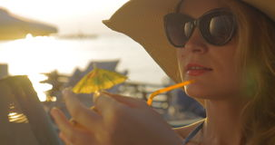 Woman in Hat and Sunglasses Drinking Cocktail stock video