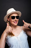 Woman in hat and sunglasses smilie Stock Photo