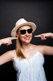 Woman in hat and sunglasses smilie Stock Photos