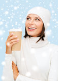 Woman in hat with takeaway tea or coffee cup Royalty Free Stock Images