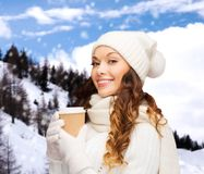 Woman in hat with takeaway tea or coffee cup Royalty Free Stock Photography