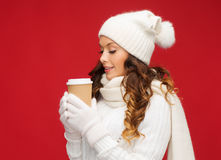 Woman in hat with takeaway tea or coffee cup Stock Images