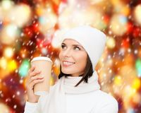 Woman in hat with takeaway tea or coffee cup Royalty Free Stock Image