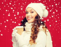 Woman in hat with takeaway tea or coffee cup Stock Image