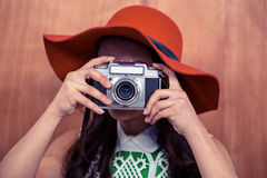 Woman with hat taking photograph with camera Royalty Free Stock Image