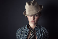 Woman in hat and tie portrait Royalty Free Stock Photography
