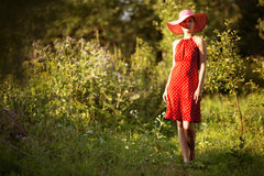 Woman in a hat walks barefoot Royalty Free Stock Photography