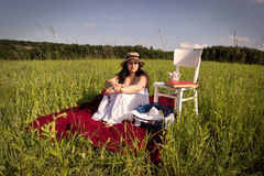 Woman with Hat and White Dress on Picnic Blanket Stock Images