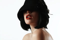 Woman in a hat and a wig Stock Photos