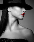 Woman in hat Stock Images