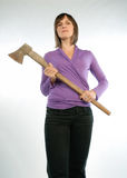 Woman with hatchet. Strict woman holding a hatchet in her hands Royalty Free Stock Photo