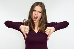 Woman hater doing dislike with thumb down. Isolated portrait Stock Photos