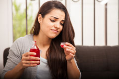 Woman hates cough syrup Stock Image