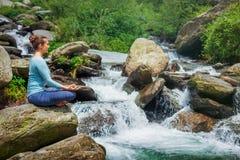 Woman in Padmasana outdoors stock image