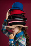 Woman and hats Stock Photography