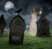 Woman Haunting Cemetery. Woman holding lantern haunts cemetery at Halloween Royalty Free Stock Photos