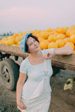 Woman have carts with ripe yellow melons Royalty Free Stock Image