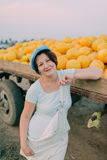 Woman have carts with ripe yellow melons Royalty Free Stock Images