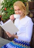 Woman have drink cafe terrace outdoors. Mug of good coffee and interesting book best combination for perfect weekend. Girl drink coffee every morning same royalty free stock image