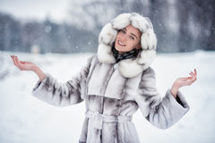 Woman have fun on the snow in winter forest Royalty Free Stock Photo