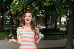 Woman have fun with soap bubbles in summer park Royalty Free Stock Photos