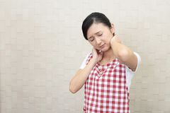 Woman have neck and shoulder pain royalty free stock photography