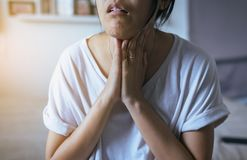 Woman have a sore throat,Female touching neck with hand,Healthcare Concepts. Woman have a sore throat,Female touching neck with hand on bedroom,Healthcare Royalty Free Stock Images