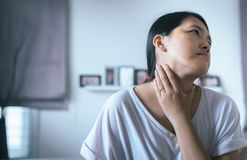 Woman have a sore throat,Female touching neck with hand,Healthcare Concepts. Woman have a sore throat,Female touching neck with her hand,Healthcare Concepts Royalty Free Stock Photography