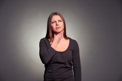 Woman have a throat pain Royalty Free Stock Photography