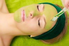 Woman having algae mud mask on face Royalty Free Stock Images