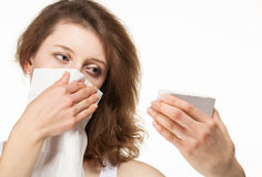 Woman having allergy and selects drug. Isolated on white background Royalty Free Stock Images