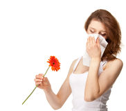 Woman having allergy from spring flowers Stock Photography