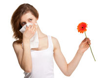 Woman having allergy from spring flowers Stock Image