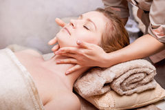 Woman having anti-aging Face massage. Caucasian women having anti-aging Face massage Royalty Free Stock Image