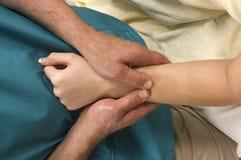 Woman having arm massaged Royalty Free Stock Image